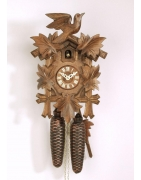 An assortment of cuckoo clocks with one day mechanism